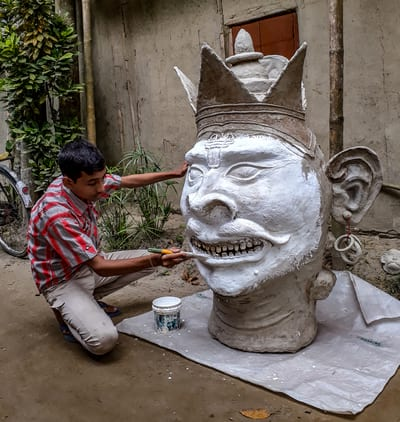 Preparing a mask for the festival